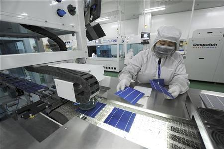 An employee inspects solar panels along a production line at an LDK Solar company workshop in Hefei, Anhui province in this November 10, 2011 file photo. REUTERS/Stringer/Files