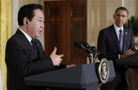 U.S. President Barack Obama (R) listens to Japanese Prime Minister Yoshihiko Noda duing a joint news conference in the East Room of the White House in Washington, April 30, 2012. REUTERS/Yuri Gripas