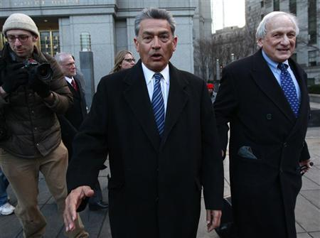 File photo of Rajat Gupta, (C) a former director of Goldman Sachs Group Inc., in New York with his lawyers, February 7, 2012. REUTERS/Brendan McDermid
