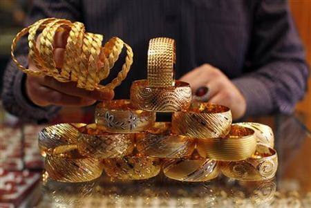 A goldsmith displays gold bangles in his jewellery shop in Istanbul April 22, 2011. REUTERS/Murad Sezer/Files