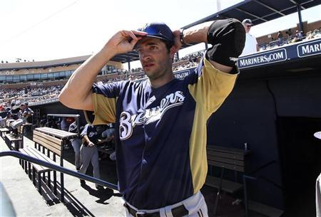 MLB's 2011 National League Most Valuable Player Ryan Braun of the Milwaukee Brewers prepares to go on the field during their MLB spring training baseball game against the San Diego Padres in Peoria, Arizona March 31, 2012. REUTERS/Darryl Webb