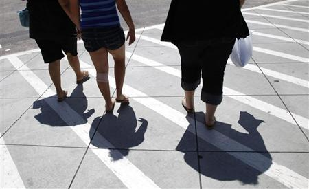 Jazmine Raygoza (R), 17, walks with her mother Veronica (L) and sister Jocelyne, 15, after shopping for father's day gifts in Denver June 18, 2011 two days before Jazmine's Lap-Band surgery. REUTERS/Rick Wilking