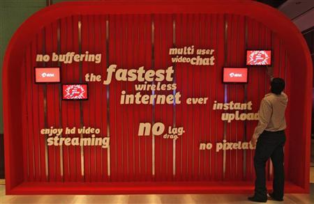 A man touches a screen on a Bharti Airtel advertisement billboard in Kolkata April 10, 2012. REUTERS/Rupak De Chowdhuri/Files