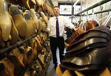 Director Barry Jones poses at Tricker's shoe factory in Northampton, central England, April 25, 2012.The small wooden door of Tricker's shoe factory unexpectedly leads to a smartly polished showroom, its dark wooden shelves home to some of the world's finest handmade shoes, as a collection of workers visible through clear glass windows go about their daily tasks. Photograph taken April 25, 2012. REUTERS/Darren Staples