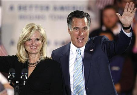 Republican presidential candidate former Massachusetts Governor Mitt Romney waves with his wife Ann after his speech at a primary night rally in Manchester, New Hampshire April 24, 2012. REUTERS/Dominick Reuter