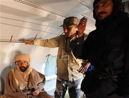 Saif al-Islam Gaddafi is pictured sitting in a plane in Zintan November 19, 2011. REUTERS/Ismail Zitouny