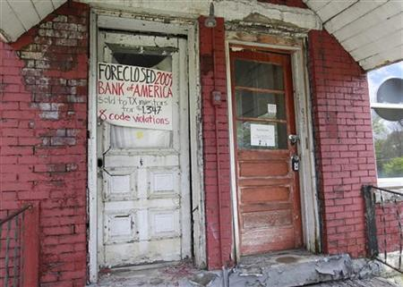 Foreclosure signs by Occupy Cincinnati hang from doors in the East Price Hill neighborhood during a protest march in Cincinnati, Ohio, March 24, 2012. REUTERS/John Sommers II