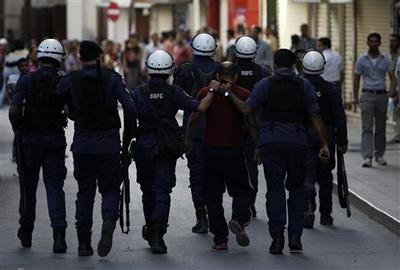Bahrain breaks up protests, faces calls to free...