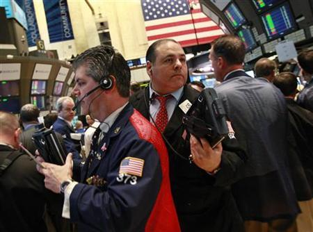 Traders work on the floor of the New York Stock Exchange, April 20, 2012. REUTERS/Brendan McDermid