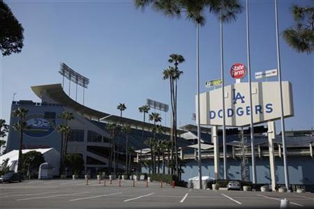 A view of the Dodger Stadium from the parking lot outside the right field scoreboard before the gates open for the Los Angeles Dodgers MLB national league baseball game home opener against the Pittsburgh Pirates in Los Angeles April 10, 2012. REUTERS/Danny Moloshok