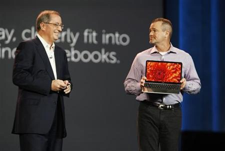 Jeff Clarke (R), vice chairman of Global Operations for Dell, displays the XPS 13, the company's first ultrabook, with Paul Otellini, president and CEO of Intel Corporation, during a keynote address at the 2012 International Consumer Electronics Show (CES) in Las Vegas, Nevada, January 10, 2012. REUTERS/Steve Marcus