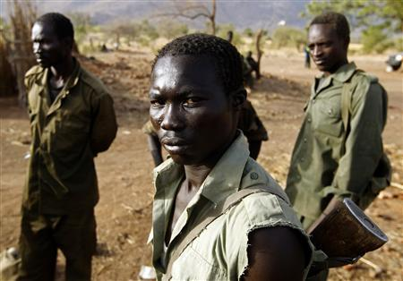 A SPLA-N fighter stands near Gos village in the rebel-held territory of the Nuba Mountains in South Kordofan, May 1, 2012. REUTERS/Goran Tomasevic