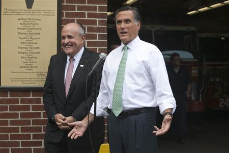 Former New York City Mayor Rudy Giuliani (L) and former Massachusetts Governor and Republican presidential candidate Mitt Romney visit Engine 24 Ladder 5 in New York May 1, 2012. REUTERS/Allison Joyce