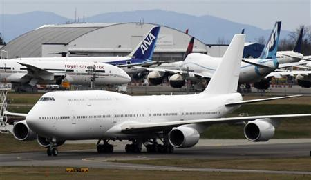 Boeing 747-8 Intercontinental jetliner the company's first VIP-configured aircraft, taxis past Boeing's widebody jetliner production facilities before taking off from Paine Field in Everett, Washington on February 28, 2012. REUTERS/Anthony Bolante