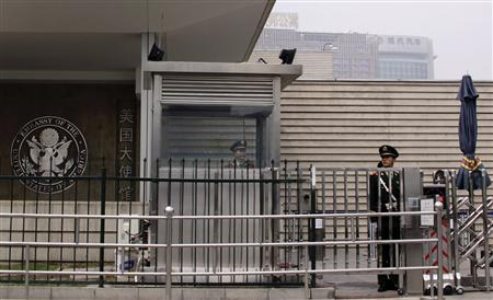 Paramilitary police officers guard the entrance to the U.S. embassy in Beijing April 30, 2012. The United States faces a tense week in China as high-level talks on trade and global hot spots like Iran and North Korea open in the shadow of a blind Chinese activist's bold escape from house arrest to seek U.S. protection in Beijing. REUTERS/Petar Kujundzic