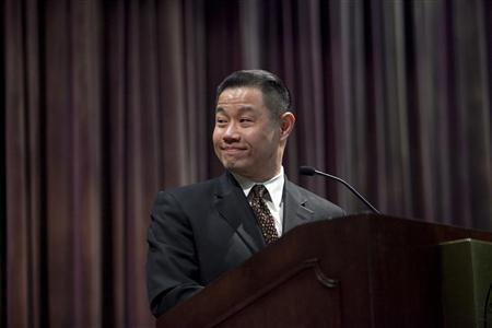 New York City Comptroller and 2013 Mayoral candidate John Liu smiles as he stands at the podium during an event at Medgar Evers College in Brooklyn, New York February 29, 2012. REUTERS/Allison Joyce