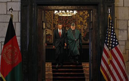 U.S. President Barack Obama (L) and Afghan President Hamid Karzai meet to sign the Strategic Partnership Agreement at the Presidential Palace in Kabul, May 2, 2012. REUTERS/Kevin Lamarque