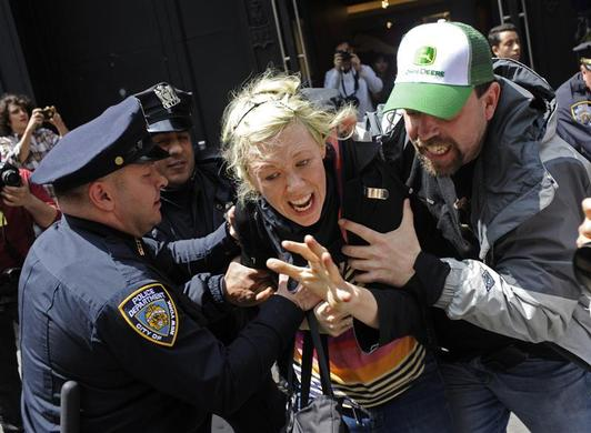 Occupy Wall Street demonstrators clash with New York Police Department officers as they are arrested during a march on Broadway in New York, May 1, 2012. REUTERS-Keith Bedford