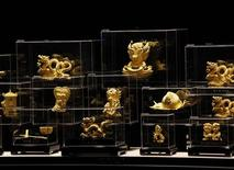 Figurines in 24K gold are displayed at a Chow Tai Fook Jewellery store in Hong Kong December 6, 2011. REUTERS/Bobby Yip