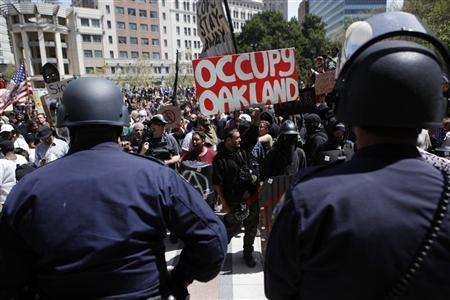 Occupy Oakland demonstrators and police stand their ground during a standoff on May Day in front of City Hall in Frank Ogawa Plaza in Oakland, California, May 1, 2012. REUTERS/Beck Diefenbach