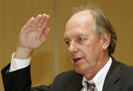 Tom Byrne, senior vice president of Moody's Investors Service, gestures as he answers media queries during the Asian Development Bank meeting in Manila May 2, 2012. The lack of a sales tax increase in Japan could bring forward ''the day of reckoning'' in the Japanese government bond (JGB) market and cause investors to demand higher premiums, Byrne said on Wednesday. REUTERS/Cheryl Ravelo