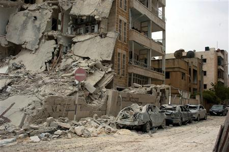 A view of the damage at the site where two bombs detonated near state buildings in the northern city of Idlib in this handout released by Syria's national news agency SANA on April 30, 2012. REUTERS/SANA/Handout