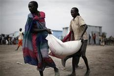 "South Sudanese who fled the recent ethnic violence carry food aid from a World Food Programme (WFP) distribution center in Pibor, Jonglei State, in this January 12, 2012 file photo. Two years ago, the U.N. Food and Agriculture Organization (FAO) launched a petition to fight hunger with the slogan: ""1,000,000,000 people live in chronic hunger and I'm mad as hell."" But outrage over the ""horrifying figure"" of 1 billion hungry people around the world has turned to embarrassment in some quarters in light of growing doubts about the accuracy of the number. Many researchers say the estimate was simply too high. The controversy led the Committee on World Food Security, to urge the FAO to overhaul its calculations using better data and methodology and to call for a set of internationally agreed food-security indicators. The first fruits are due in October when a new estimate of the number of undernourished people will be published along with revisions for previous years as part of the FAO's annual report on food insecurity. REUTERS/Hereward Holland/Files"