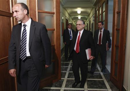 Greece's Prime Minister Lucas Papademos (2nd R) arrives for a cabinet meeting at the parliament in Athens May 2, 2012. Greece will call a snap election for May 6. REUTERS/John Kolesidis