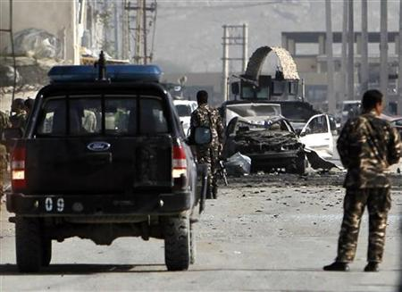 Afghan security forces members inspect the site of a car bomb attack in Kabul May 2, 2012. REUTERS/Omar Sobhani