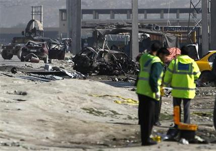 Afghan security forces members inspect the site of a car bomb attack in Kabul May 2, 2012. At least six people were killed in the suicide car bomb attack in the Afghan capital on Wednesday, officials said, hours after U.S. President Barack Obama left Kabul following an unannounced visit during which he signed a strategic partnership agreement. REUTERS/Omar Sobhani