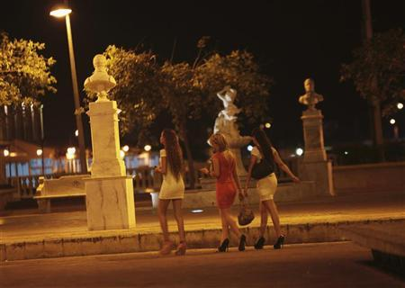 Prostitutes walk a street of the old city, as heads of state met for the Americas Summit in Cartagena, April 14, 2012. Headlines from this weekend's gathering of more than 30 heads of state have focused on an embarrassing scandal after members of U.S. President Barack Obama's security detail were caught with prostitutes in historic Cartagena. Picture taken April 14. REUTERS/Joaquin Sarmiento