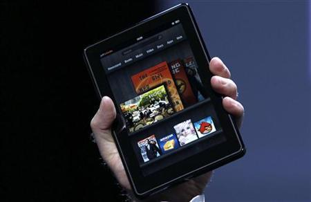 Amazon CEO Jeff Bezos holds up the new Kindle Fire at a news conference during the launch of Amazon's new tablets in New York, September 28, 2011. REUTERS/Shannon Stapleton/Files