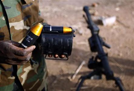 A SPLA-N fighter shows ammunition for a grenade launcher captured from Sudan's Armed Forces (SAF) near Gos village in the rebel-held territory of the Nuba Mountains in South Kordofan, May 1, 2012. REUTERS/Goran Tomasevic