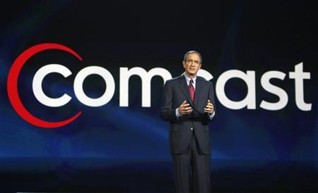 Comcast Chief Executive Officer Brian Roberts speaks at his keynote address at the Consumer Electronics Show in Las Vegas, Nevada in this January 8, 2008 file photo. Comcast Corp posted a better-than-expected quarterly profit on continued growth in high-speed internet subscribers, a strong performance at its movie studio, and signs of a turnaround at its NBC broadcast business. REUTERS/Rick Wilking/Files