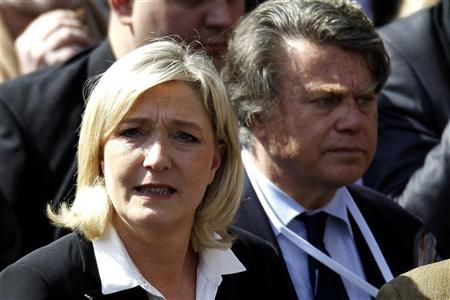 France's far right National Front political party leader Marine Le Pen (L) and French lawyer Gilbert Collard attend the National Front's annual May Day rally in Paris May 1, 2012. REUTERS/Charles Platiau