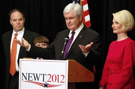 Former Speaker of the House Newt Gingrich stands next to his wife, Callista (R), son-in-law Jimmy Cushman and grandson Robert (2nd L) as he drops out of the race for the GOP presidential nomination while in Arlington, Virginia, May 2, 2012. REUTERS/Larry Downing