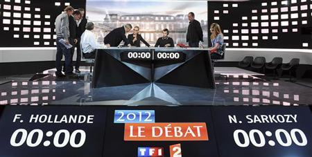 People work at the television studio in La Plaine Saint-Denis, near Paris, on the eve of the televised debate for the 2012 French presidential election campaign between Nicolas Sarkozy, France's President and UMP party candidate for his re-election, and Francois Hollande, Socialist party candidate, May 1, 2012. REUTERS/Franck Fife/Pool