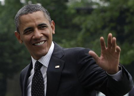 U.S. President Barack Obama waves as he walks on the South Lawn of the White House upon his return to Washington May 2, 2012 after a trip to Afghanistan. REUTERS/Yuri Gripas