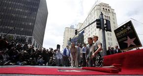 Actress Scarlett Johansson and actor Jeremy Renner pose by her star after it was unveiled on the Walk of Fame in Hollywood, California May 2, 2012. REUTERS/Mario Anzuoni