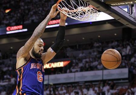 New York Knicks center Tyson Chandler dunks the ball in the third quarter of play against the Miami Heat during Game 2 of their first round NBA Eastern Conference basketball playoff in Miami, Florida April 30, 2012. REUTERS/Andrew Innerarity