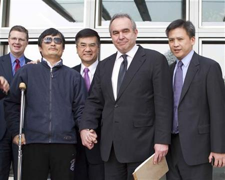 A handout photo from US Embassy Beijing Press office shows blind activist Chen Guangcheng (2nd L) shaking hands with U.S. Assistant Secretary of State for East Asian and Pacific Affairs Kurt Campbell (2nd R) as they stand with U.S. Ambassador to China Gary Locke (C), in Beijing, May 2, 2012. REUTERS/US Embassy Beijing Press Office/Handout