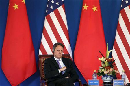 U.S. Treasury Secretary Timothy Geithner sits in front of Chinese and U.S. national flags during the opening ceremony of the U.S.-China Strategic and Economic Dialogue at the Diaoyutai State Guesthouse in Beijing May 3, 2012. Geithner said China is strong enough to handle the economic and financial reforms that the United States seeks. REUTERS/Jason Lee