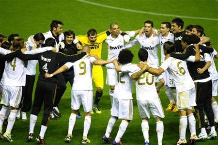 Real Madrid players celebrate after their 3-0 win over Athletic Bilbao gave them the Spanish first division league title at San Mames stadium in Bilbao May 2, 2012. REUTERS/Vincent West