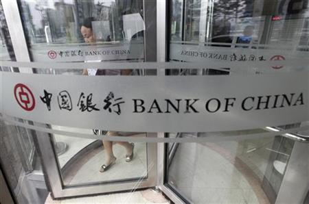 A woman leaves a branch of Bank of China in Beijing July 6, 2011. REUTERS/Jason Lee/Files