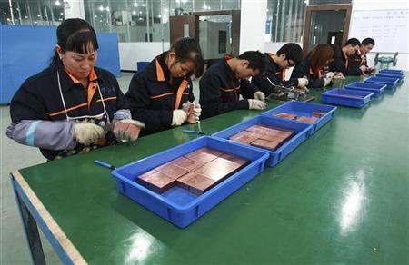 Employees process radiator components at a factory in Suining, Sichuan province April 5, 2012. REUTERS/Stringer