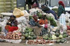 Women sell vegetables and fruits on the roadside in Nairobi, Kenya, June 19, 2008. REUTERS/Antony Njuguna