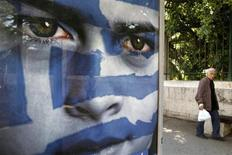 A man walks past a pre-election poster of the Democratic Alliance party at a bus station in Athens May 3, 2012. Greece holds general elections on May 6. REUTERS/Yorgos Karahalis