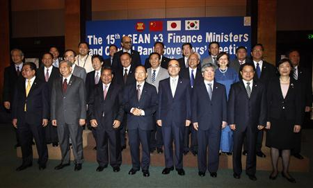 Ministers and governors pose for a picture after the 15th ASEAN plus 3 Finance Ministers and Central Bank Governors' meeting in Manila May 3, 2012. China, Japan and South Korea agreed on Thursday to boost cross-investment in government bond markets, worth nearly a combined $15 trillion, in a move that will better prepare the countries to protect their financial markets from external shocks. REUTERS/Romeo Ranoco