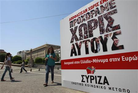 People walk past an election campaign kiosk of the Left Coalition party in Athens May 3, 2012. Greece will call a snap election for May 6. The poster reads: ''We are moving on without them'' REUTERS/John Kolesidis
