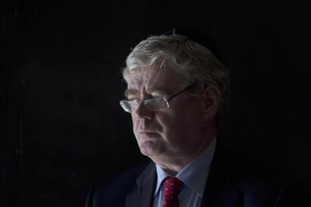 Irish Deputy Prime Minister Eamon Gilmore leaves after a ceremony in the Hall of Remembrance at the Yad Vashem Holocaust Memorial in Jerusalem January 29, 2012. REUTERS/Baz Ratner